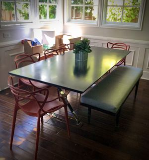 Dark wood table and 8 orange chairs. for Sale in Newport Beach, CA