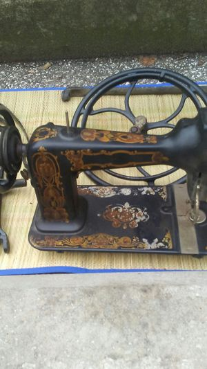 Antique sewing machine with table parts for Sale in Cleveland, OH
