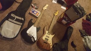 Two rarely used guitars, rarely used amp that's still in box, two basic guitar bags, a tuner, and guitar kit that has extra strings and etc. for Sale in Aurora, CO