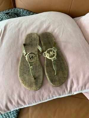 Michael Kors gold size 6 flip flops for Sale in Seattle, WA
