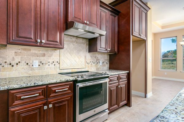 Laminated floor installation, kitchen cabinets and more