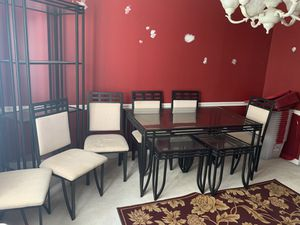 Glass dining set with six chairs , two end tables and showcase piece. for Sale in Nashville, TN