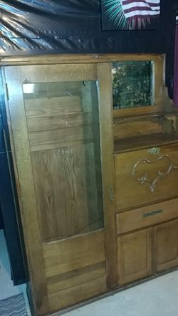 Antique oak side-by-side secretary with desk, beveled mirror, storage and glass front closet. for Sale in Dahlonega,  GA