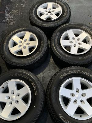 Semi new wheels and tires 5 of them fit all jeeps tires 80%tread for Sale in San Diego, CA