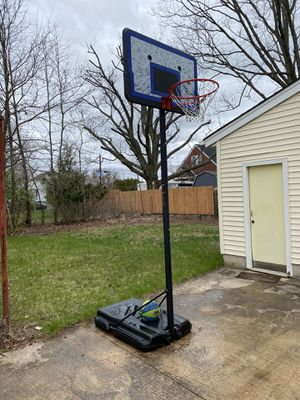 Portable height adjustable basketball hoop and basketball for Sale in Somerset, NJ