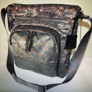 New Tumi Voyageur Carmel Crossbody Bag for Sale in Woodinville, WA
