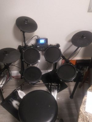 Alesis nitro mesh kit with upgraded double kick pedal and throne for Sale in Corona, CA