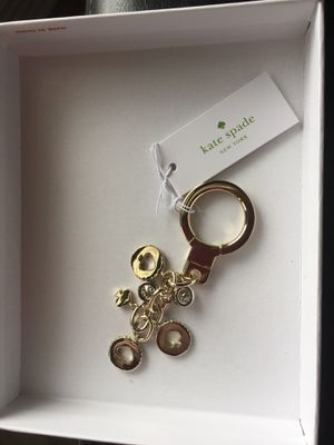 New in box Kate Spade key chain. Beautiful gold color. for Sale in Houston, TX
