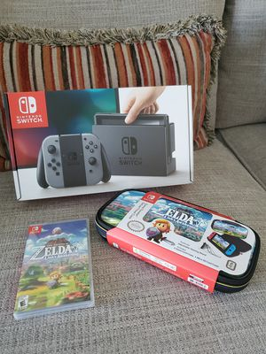 NINTENDO SWITCH WITH ZELDA LINK'S AWAKENING AND TRAVEL CASE (NEW - NO TRADES) for Sale in Orlando, FL