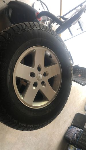 Jeep Wrangler 5 stock wheels with tires 255/75R17 for Sale in Riverside, CA