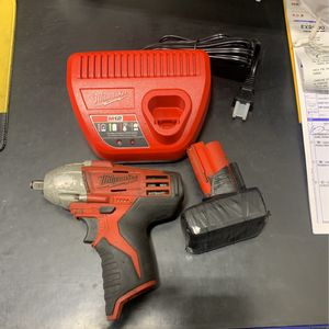 Milwaukee 3/8 impact with battery and charger for Sale in Chardon, OH