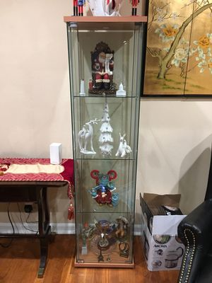Two shelf curio this lovely cabinet brings chic display to any space. Highlight favorite family photos or share your treasured for Sale in Sterling, VA