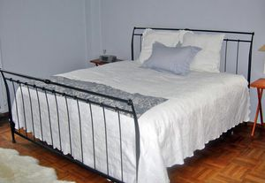 King size bed frame with foot board and headboard. Can also fit 2 XL twin mattresses. for Sale in New York, NY