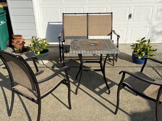 Beautiful 4 Piece Outdoor Patio Set, Glider Loveseat and Granite Table for Sale in Troutdale,  OR