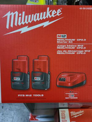 Milwaukee charger kit with 2 batteries for Sale in Sachse, TX