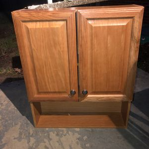 Light wood bathroom wall cabinet with adjustable shelves inside. Never been used! for Sale in Saint Albans, WV