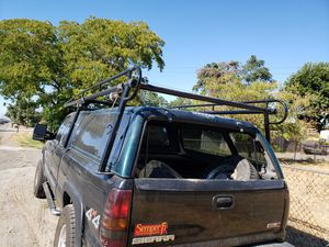 Around tge shell Lumber racks and campershell for Sale in Manteca, CA