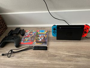 Nintendo switch bundle (includes extra controller, console, 4 games!!! Mario Odyssey, Mariokart, Super Mario party, crash bandicoot!) for Sale in Fort Lauderdale, FL