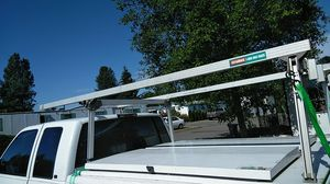 Really nice ladder rack with secure lid compartments that flip up on both sides for Sale in SeaTac, WA