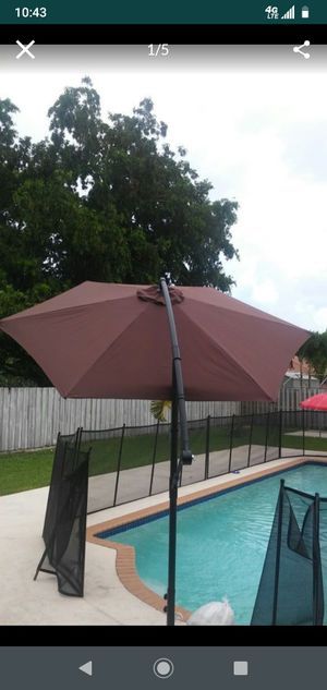 New in the box. 10 feet offset Umbrella. If posted, it's available. Bran new in the box untouched. 360 degrees turn, Elegant. Rain or sun protection. for Sale in Miami, FL