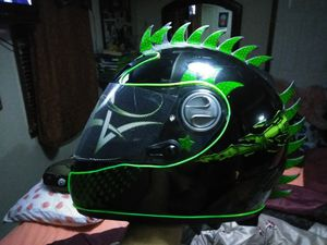 Motorcycle helmet, eylure the price just for this week for Sale in Boston, MA