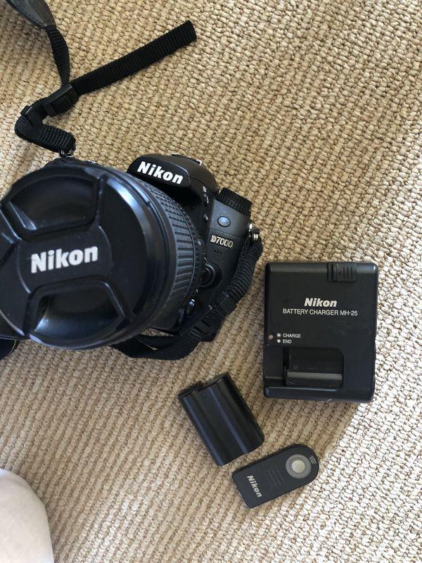 Nikon d7000 with lens, 2 batteries