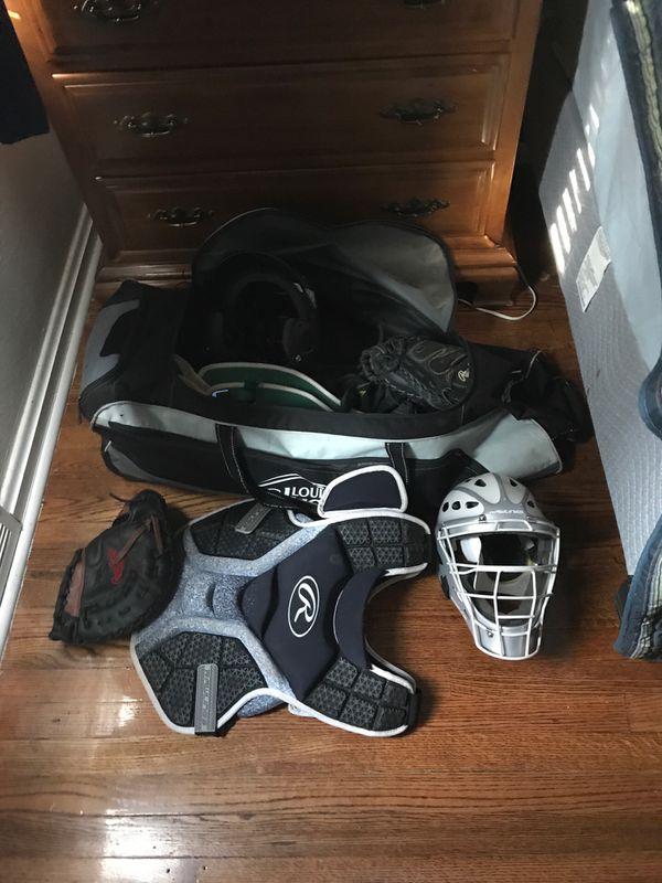 Catchers gear. Gloves. Bat.