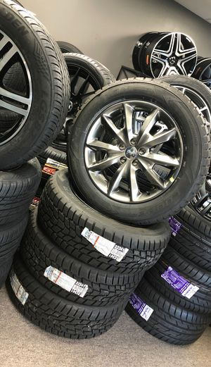 18 oem Jeep Cherokee new wheels tires sensors and caps for Sale in Warren, MI