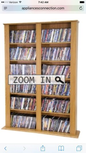 New CD / DVD / Video Storage Tower with Sixteen Adjustable Shelves and Two Fixed Shelves in Oak for Sale in Bessemer, AL