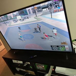 55 Inch Roku Tv And Tv Stand for Sale in Newburgh Heights, OH