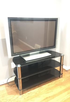 TV and TV stand works great surroundsound for Sale in Dearborn, MI