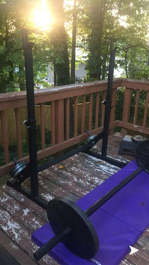 Adjustable Squat/Lifting rack, axle barbell and curl bar and plates! Great price! for Sale in Herndon, VA