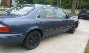 2002 Mazda 28 miles per gallon runs great for Sale in Saginaw, MI