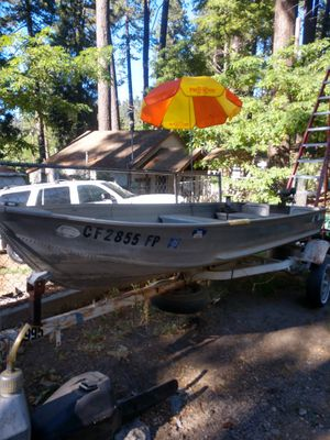 Sears 14 ft aluminum fishing boat . Boat motor 5 hp .boat trailer for Sale in Crestline, CA