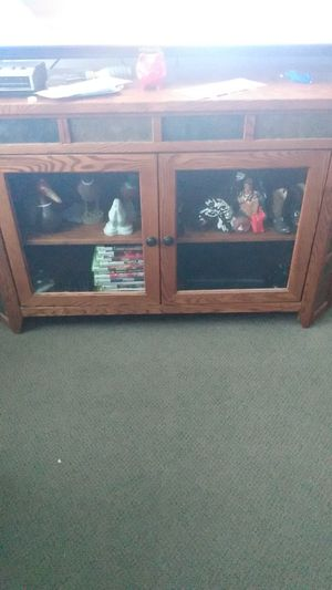 I have a TV stand for for Sale in Wellington, KS