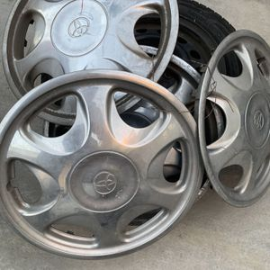 Toyota Corolla original wheel With Rim Covers for Sale in Huntington Beach, CA