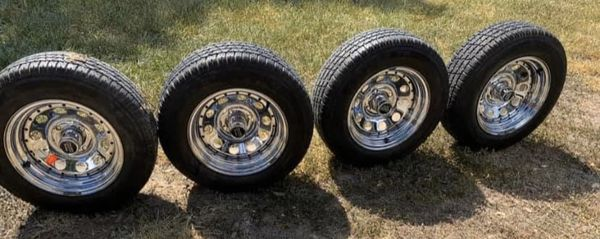 Make a serious offer/ 4 lug set / mint condition rims and tires
