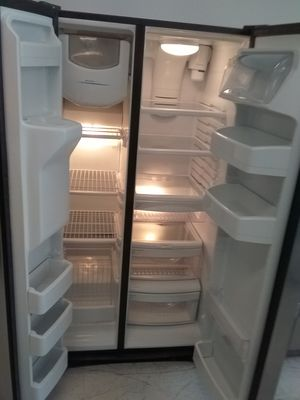 Whirlpool side by side stainless steel refrigerator used good condition 90days warranty for Sale in Mount Rainier, MD