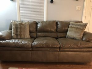 One year old brown leather couch , oversized chair , with ottoman for Sale in Nashville, TN