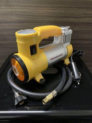 New in box Portable Air Compressor Pump 12V Multi-Use mini Compressor Tire Pump Inflator Plugs in to cigarette lighter outlet built in flashlight for Sale in Whittier, CA