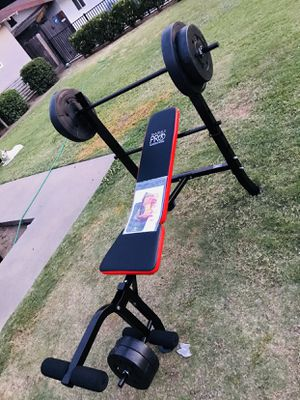 pro marcy weight bench with 100 pounds weights new for Sale in Fresno, CA