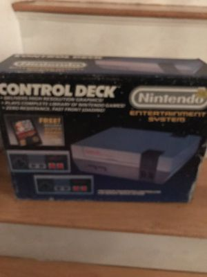 original nintendo console with 4 remotes 2 guns and games for Sale in Boston, MA