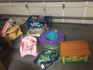 2 dollhouses, baby jumper, booster chair, bumbo chair with activity tray,toy box with games and stuffed animals for Sale in Port St. Lucie, FL
