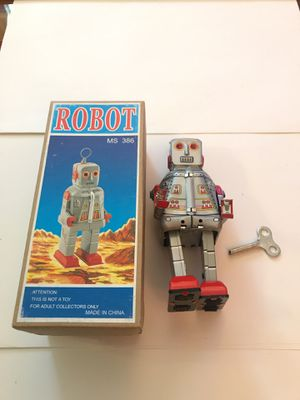 Collectible robot Wind Up Tin Toys w/ Key Home Decor for Sale in Eagle, WI
