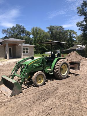 John Deere tractor with loader and box blade for Sale in Tampa, FL