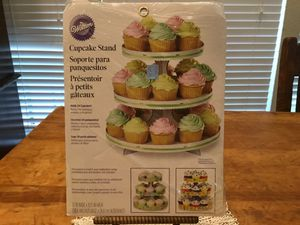 Wilton cardboard cupcake stand for 24 cupcakes. Sturdy and takes very little space in kitchen cabinet or pantry. Super cool for Sale in Austin, TX