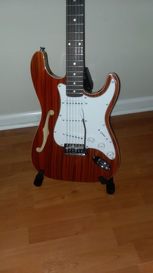Cozart semi-hollow w/maple body and neck w/cocobola top for Sale in West Palm Beach, FL