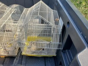 Bird cages 3 of them comes with wood sticks, food bowls ect. 50 for all three. Or 17 each for Sale in Sandy, UT