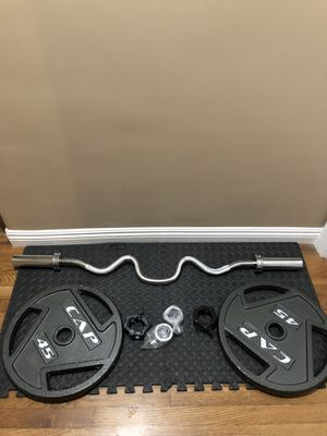 Olympic curling super bar/Barbell, fast locking Olympic style collars, and pair of 45lbs Olympic plates/ weights for Sale in San Gabriel, CA