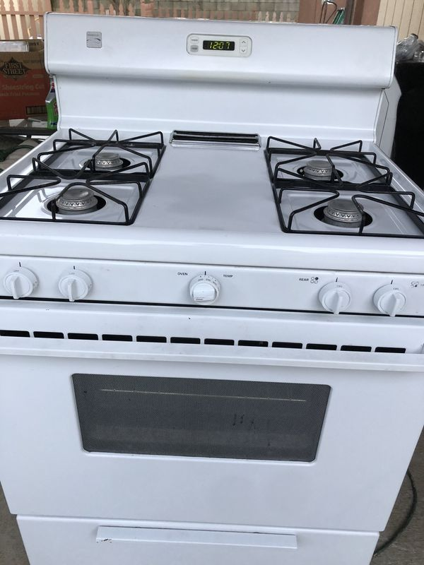 "1 yr old kenmore 32"" gas stove very clean in and out works perfectly must see could deliver for charge hardly used the oven"
